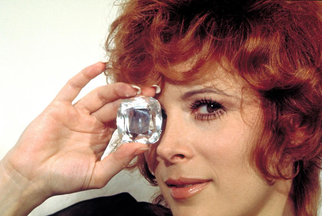 """TIFFANY CASE   MOVIE: <a href=""""http://movies.yahoo.com/movie/1800057086/info"""">Diamonds Are Forever</a>  ACTRESS: <a href=""""http://movies.yahoo.com/movie/contributor/1800012708"""">Jill St. John</a>  ALLEGIANCE: The Spangled Mob  LAST SEEN: Sailing into the sunset with Bond.  SPECIAL SKILLS: Diamond smuggling, climbing oil rigs, hiding cassette tapes in her bikini."""