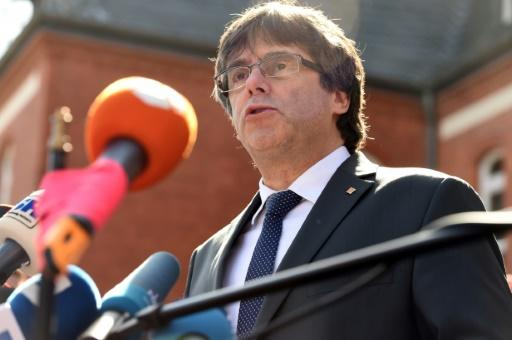 Deposed Catalan leader Carles Puigdemont is in exile in Germany and faces jail on rebellion charges if he returns to Spain