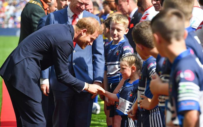 Rugby liege: The Duke of Sussex met mascots at the Challenge Cup Final at Wembley Stadium - REX
