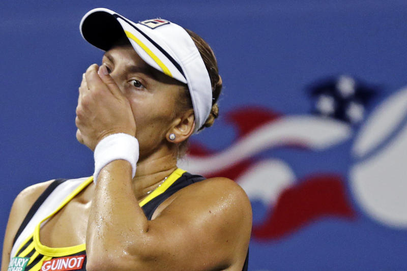 Nadia Petrova, of Russia, reacts after losing a point to Maria Sharapova, of Russia, in the fourth round of play at the U.S. Open tennis tournament, Sunday, Sept. 2, 2012, in New York. (AP Photo/Charles Krupa)