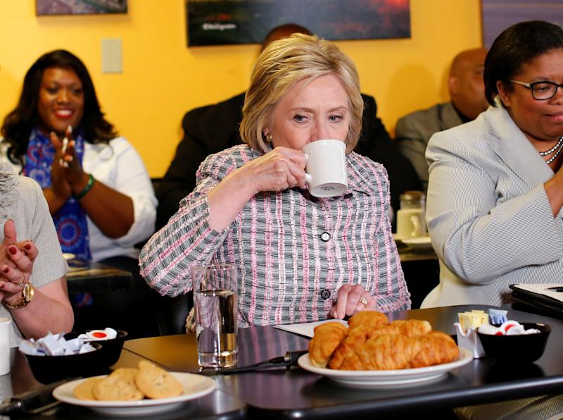 Clinton sips coffee during a campaign stop at a small restaurant in Vallejo, California on June 5, 2016.  (Mike Blake / Reuters)
