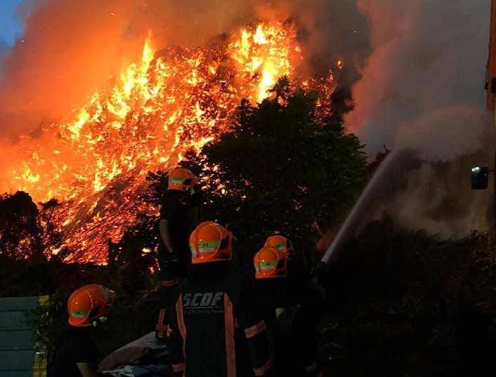 SCDF personnel fighting the fire at Lorong Semangka (PHOTO: SCDF/Facebook)