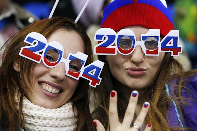 Russian fans sport 2014 glasses as they cheer during the 2014 Winter Olympics women's ice hockey game between Russia and Germany at Shayba Arena, Sunday, Feb. 9, 2014, in Sochi, Russia. (AP Photo/Petr David Josek)