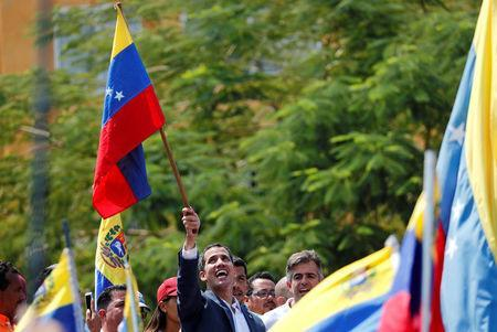 Venezuelan opposition leader Juan Guaido, who many nations have recognised as the country's rightful interim ruler, takes part in a rally against Venezuelan President Nicolas Maduro's government, in Guacara, Venezuela March 16, 2019. REUTERS/Carlos Jasso
