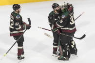 Arizona Coyotes' Jordan Oesterle (82), Alex Goligoski (33) and goalie Darcy Kuemper (35) celebrate the win over the Colorado Avalanche in an NHL hockey Stanley Cup first-round playoff series, Saturday, Aug. 15, 2020, in Edmonton, Alberta. (Jason Franson/The Canadian Press via AP)