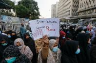 A woman carries a placard demanding justice during a protest in Karachi,