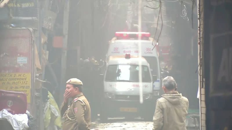 Video grab of ambulences at the scene of a deadly fire that swept through a factory where laborers were sleeping, in New Delhi