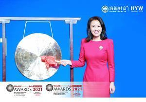 Hywin Wealth CEO Madame Wang Dian rings a gong at a ceremony in Shanghai to celebrate the company's NASDAQ listing, March 26, 2021.