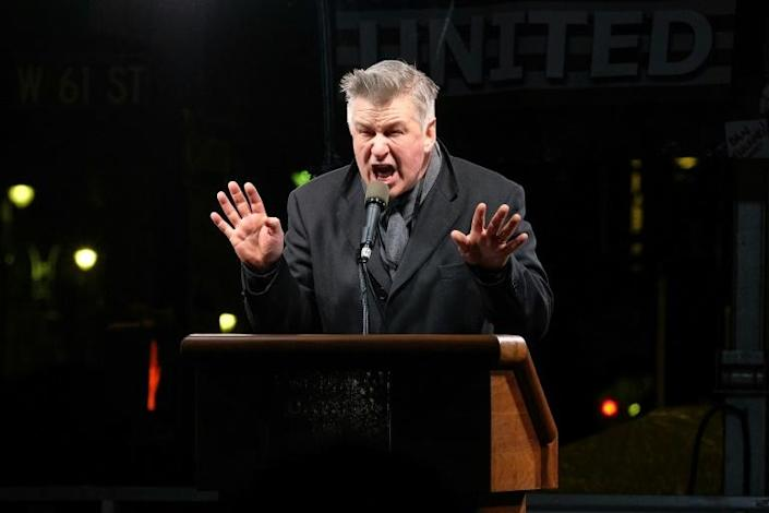 """Actor Alec Baldwin, who plays Trump on """"Saturday Night Live,"""" speaks during a rally outside Trump International Hotel & Tower in New York in January 2017 (AFP Photo/D Dipasupil)"""