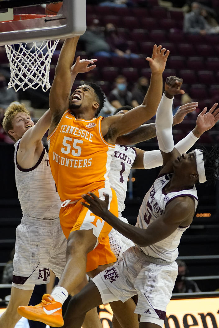 Tennessee forward E.J. Anosike (55) fights for a rebound against the interior of the Texas A&M defense during the first half of an NCAA college basketball game Saturday, Jan. 9, 2021, in College Station, Texas. (AP Photo/Sam Craft)