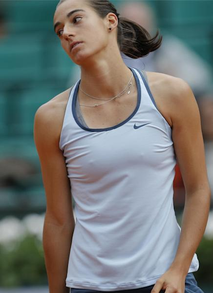 Caroline Garcia of France turns away after missing a return against Serena Williams of the U.S. in their second round match of the French Open tennis tournament, at Roland Garros stadium in Paris, Wednesday, May 29, 2013. Williams won in two sets 6-1, 6-2. (AP Photo/Christophe Ena)