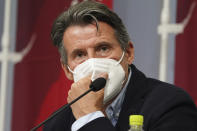 Sebastian Coe, president of World Athletics, listens to a reporter's question during a press conference as Coe visited an athletics test event for the Tokyo 2020 Olympics Games at National Stadium in Tokyo, Sunday, May 9, 2021. (AP Photo/Shuji Kajiyama)