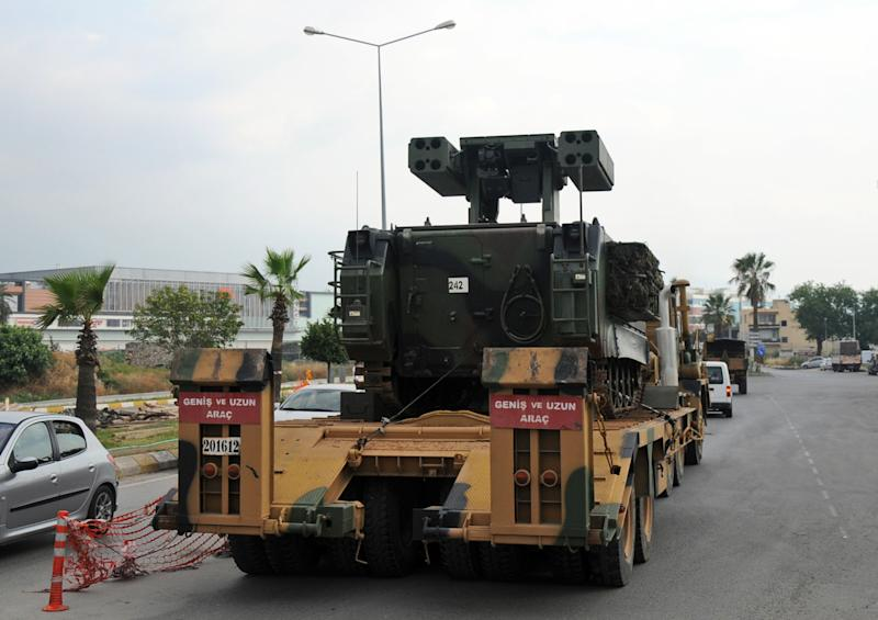 In this photo taken Wednesday, June 27, 2012, a Turkish military truck transports a mobile missile launcher to the Syrian border, in Iskenderun, Turkey. Turkey is deploys antiaircraft units along its border with Syria following the downing of one of its warplanes by Syrians.(AP Photo)