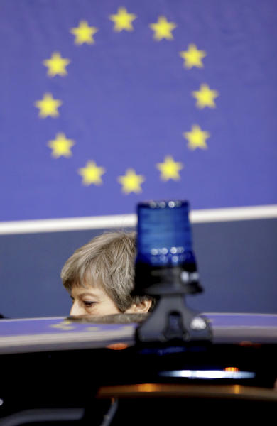 British Prime Minister Theresa May leaves at the end of an EU summit in Brussels, Friday, March 22, 2019. Worn down by three years of indecision in London, EU leaders on Thursday were grudgingly leaning toward giving the U.K. more time to ease itself out of the bloc. (AP Photo/Olivier Matthys)