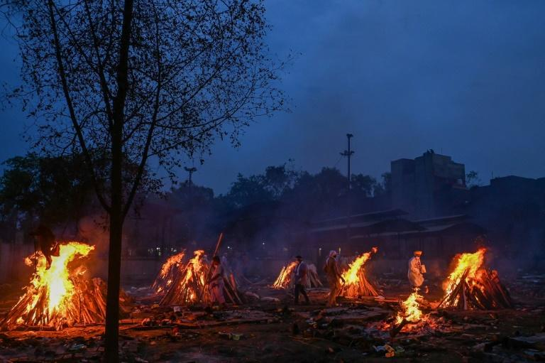Funeral pyres for people who died of Covid-19 in New Delhi. India is battling a record-breaking coronavirus surge and Australia has imposed a complete travel ban, stranding thousands of its citizens