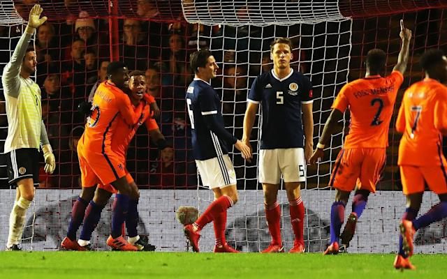 Scotland suffered their only defeat of 2017 in this desultory friendly, where the only goal of the game was scored shortly before half-time by Memphis Depay. There was no mother lode of new Scottish talent but the consolations were decent performances by Hibs' John McGinn and Callum McGregor, on the occasion of the Celtic midfielder's first cap. The impressive momentum of Kieran Tierney's career was extended by his elevation to the captaincy at the age of 20. The Isle of Man-born defender had been shifted to centre-back to permit Ryan Jack and Andrew Robertson to occupy the full-back berths, behind a sitting pair of John McGinn and Kenny McLean, who renewed an acquaintanceship that dated from their spell together at St Mirren between 2012 and 2015. The injuries to Scott Brown and Stuart Armstrong which kept them out of the side also deprived the Scots of punch and penetration in the middle of the park, but Mackay's players started positively and quickly forced three successive corner kicks. There were also promising efforts from Matt Phillips, in his makeshift role as lone striker, and James Forrest, all of which were blocked or deflected. The early stages featured oddities, a couple of which were embarrassing, such as the prolonged stoppage while a replacement was found for the match ball, which the French referee decreed to be too soft. Another blemish was the boos directed at Ryan Jack by a few Aberdeen supporters who decided that their objection to a former Dons player who had moved to Rangers should be directed at him when he was wearing the colours of his country. Depay's goal proved to be the winner Credit: Getty Images Virgil van Dijk was also the target of jeers from the main stand although, in the case of the Dutch defender, the cause appeared to be his previous employment at Celtic. More pertinently, Van Dijk was not as troubled as he should have been by Scotland's strivings on the field. Given that he and his fellow centre-back, Karim Rekkik, were frequently left alone as their full-backs pressed upfield, they were rarely stretched to cover as they should have been. In fact, the Scots' best effort in the first half came when Tierney ventured upfield for a 30-yard shot with the power and accuracy to trouble Jasper Cillessen, but the Barcelona goalkeeper dived full length to parry the drive. Cillessen looked much less adept when he made a hash of clearing a back pass and had the ball taken off his toe by Phillips, who found Ryan Christie, but the winger overhit his return cross and the chance was lost. By that stage, the Dutch were ahead, having caught Scotland shortly before the interval with a classic counterpunch which saw them break three against three in front of Craig Gordon. Caretaker manager Malky Mackay orders his instructions from the touchline Credit: Reuters The ball was worked to the right flank for Ryan Babel, whose dipping cross to the back post was met by Depay's outstretched left boot for a simple steer into the Scottish net. McGinn had cheered the Tartan Army with a forceful shot that swirled narrowly wide and McGregor came closer with a 22-yard drive which Cillessen blocked just below the crossbar but the home supporters only found their full voice when Ryan Fraser came on for Forrest and, with his first touch, left Nathan Ake static as he cut into the Dutch box for a clipped attempt which skipped a few inches to the side of the post. Jason Cummings enlivened the closing moments with a substitute appearance which saw him shoot straight at the goalkeeper to complete a frustrating evening for Malky Mackay – acting as interim manager - who had learnt earlier from the SFA chief executive, Stewart Regan, that he was not being considered for the position in the longer term.