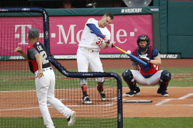 Joc Pederson, of the Los Angeles Dodgers, hits during the Major League Baseball Home Run Derby, Monday, July 8, 2019, in Cleveland. The MLB baseball All-Star Game will be played Tuesday. (AP Photo/Ron Schwane)