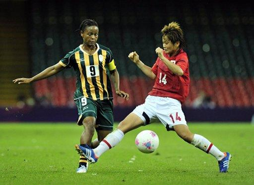 South Africa's midfielder Amanda Dlamini (L) fights for the ball with Japan's midfielder Asuna Tanaka