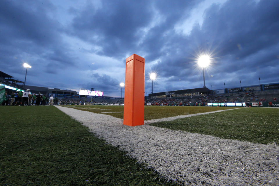 An end zone pylon against an evening sky.