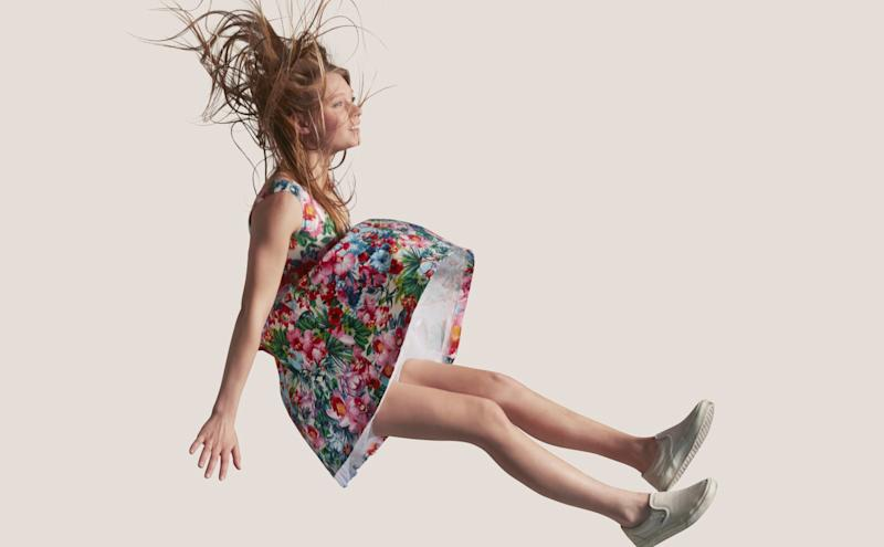 A woman in a floral dress falling directly down.