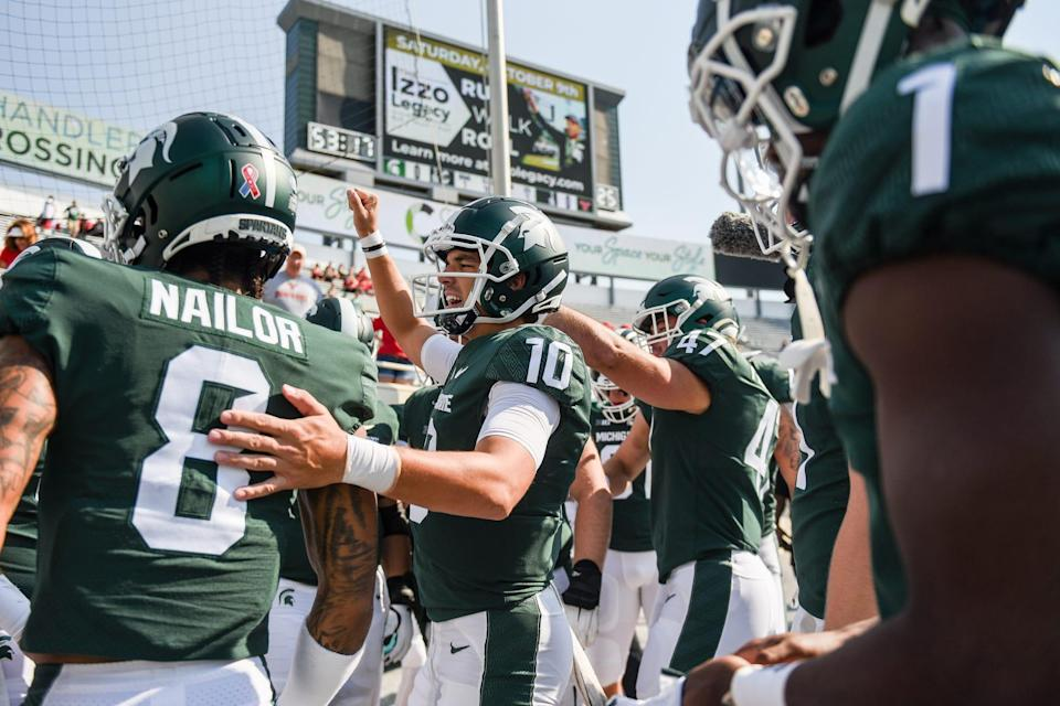 Payton Thorne, center, rallies with the team before Michigan State's football game against Youngstown State on Saturday, Sept. 11, 2021, in East Lansing.