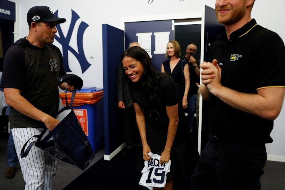 <p>Could baby Archie have a future career with the New York Yankees? Before the team's game against the Boston Red Sox at London Stadium, the team gifted the Duke and Duchess of Sussex an adorably tiny jersey, and Meghan seems to approve.<br></p>
