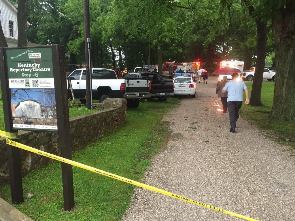 Officials stand on the scene after over a dozen people who exploring Hidden River Cave were trapped by rising water Thursday, May 26, 2016, in Horse Cave, Ky. Horse Cave Fire Chief Donnie Parker said the rising water was caused by heavy rains in the area Thursday afternoon. (Austin Anthony/Daily News via AP) MANDATORY CREDIT