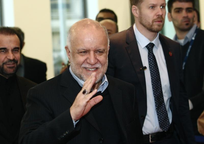 Iranian Oil Minister Zanganeh wave to journalists as he arrives for a meeting of OPEC oil ministers at OPEC's headquarters in Vienna