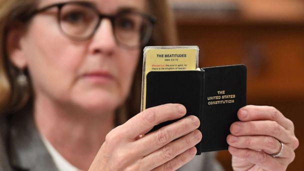 PHOTO: Democratic Rep. Madeleine Dean holds a copy of the U.S. Constitution during the House Judiciary Committee's markup of House Resolution 755, Articles of Impeachment Against President Donald Trump, on Capitol Hill in Washington, Dec. 12, 2019. (AFP via Getty Images)