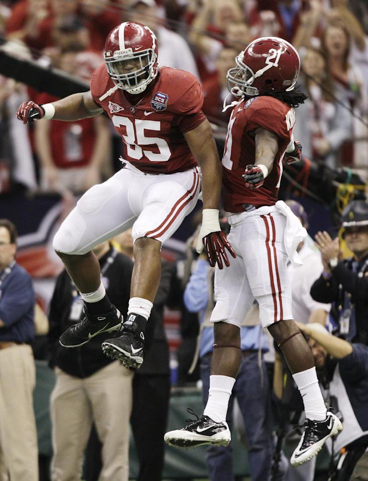 Alabama's Nico Johnson (35) and Dre Kirkpatrick (21) celebrate after stopping LSU's Tyrann Mathieu on a kick off return during the second half of the BCS National Championship college football game Monday, Jan. 9, 2012, in New Orleans. (AP Photo/David J. Phillip)