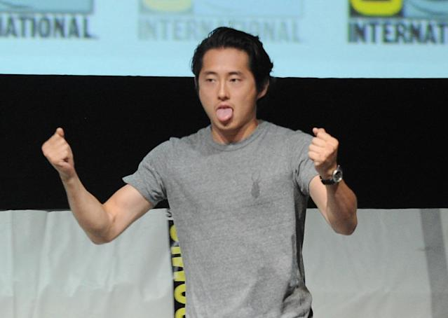 "Steven Yeun speaks onstage at AMC's ""The Walking Dead"" panel during Comic-Con International 2013 at San Diego Convention Center on July 19, 2013 in San Diego, California."