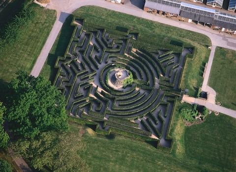 The maze at Leeds Castle comprises 2,400 yew trees - Credit: GETTY
