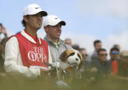 Northern Ireland's Rory McIlroy waits to tee off with his caddie on the 3rd tee during the second round of the British Open Golf Championship at Royal St George's golf course Sandwich, England, Friday, July 16, 2021. (AP Photo/Ian Walton)