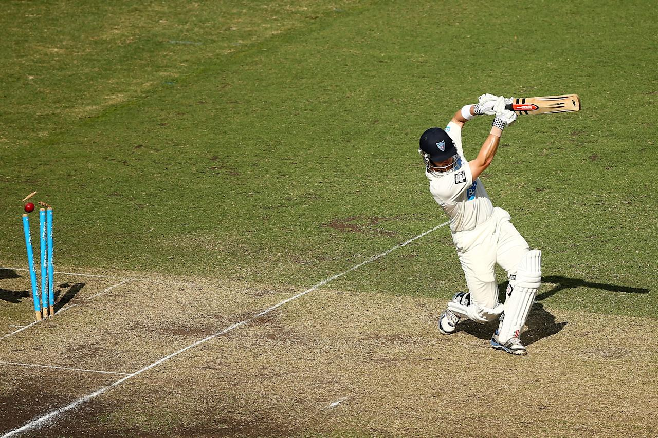 SYDNEY, AUSTRALIA - NOVEMBER 23:  Peter Nevill of the Blues is bowled by Nathan Hauritz of the Bulls during day two of the Sheffield Shield match between the New South Wales Blues and the Queensland Bulls at Sydney Cricket Ground on November 23, 2013 in Sydney, Australia.  (Photo by Matt King/Getty Images)