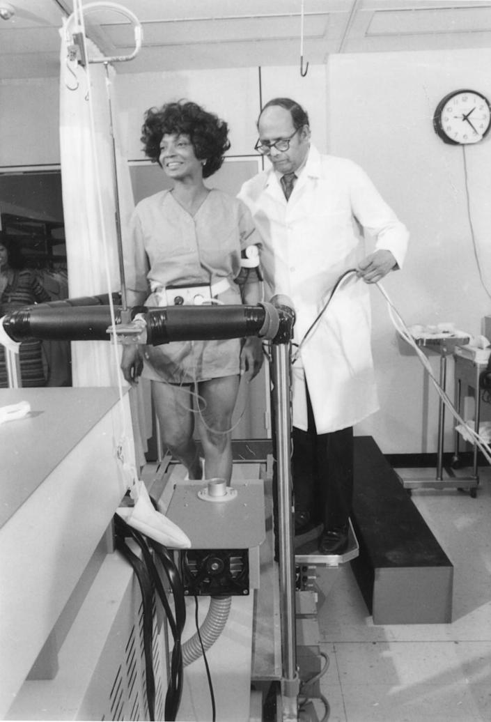 With a NASA doctor nearby, Nichelle Nichols walks on a treadmill in 1977 as part of her work recruiting women and POC.