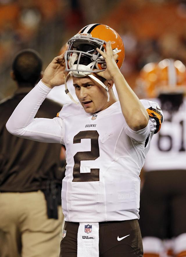 Cleveland Browns quarterback Johnny Manziel waits on a replay challenge by the St. Louis Rams in the fourth quarter of a preseason NFL football game Saturday, Aug. 23, 2014, in Cleveland. (AP Photo/Tony Dejak)