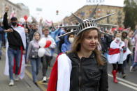 A woman wearing a crown similar to the one on the American statue of Liberty, during an opposition rally to protest the official presidential election results in Minsk, Belarus, Sunday, Sept. 27, 2020. Tens of thousands of demonstrators marched in the Belarusian capital calling for the authoritarian president's ouster, some wearing cardboard crowns to ridicule him, on Sunday as the protests that have rocked the country marked their 50th consecutive day. (AP Photo/TUT.by)