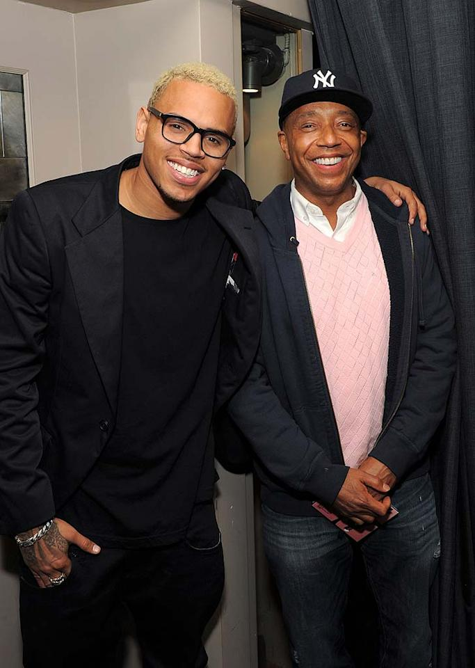 "Later, Chris grabbed some dinner with celebrity supporters, such as Russell Simmons, at Big Apple steakhouse Abe and Arthur's. He also headed over to Webster Hall to perform some new tunes. Larry Busacca/<a href=""http://www.gettyimages.com/"" target=""new"">GettyImages.com</a> - March 22, 2011"