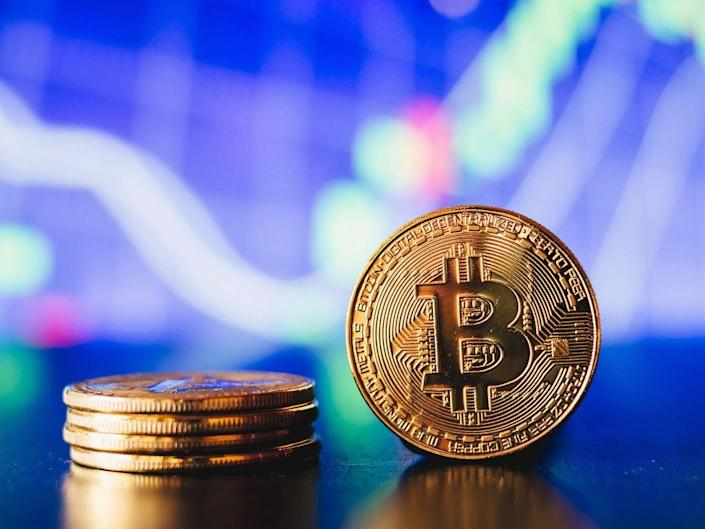 Bitcoin is experiencing major price gains in October, with crypto analysts predicting a record end to 2021 (Getty Images)