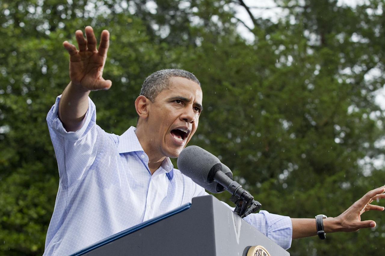 President Barack Obama campaigns during a downpour at the historic Walkerton Tavern & Gardens in Glen Allen, Va., near Richmond Saturday, July 14, 2012. It is in the Congressional district represented by House Majority Leader Eric Cantor, R-Va., a key county in a crucial swing state, part of a region that could decide the fight for Virginia's 13 critical electoral votes. (AP Photo/J. Scott Applewhite)