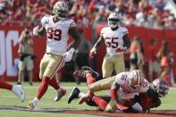 San Francisco 49ers middle linebacker Kwon Alexander (56) hits Tampa Bay Buccaneers quarterback Jameis Winston (3) on ther turf during the first half an NFL football game, Sunday, Sept. 8, 2019, in Tampa, Fla. Alexander was ejected from play. (AP Photo/Chris O'Meara)