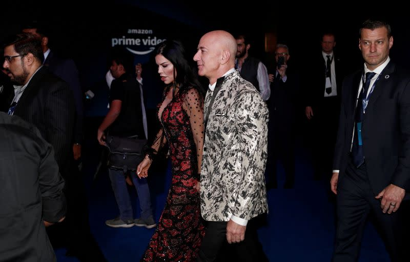 FILE PHOTO: Jeff Bezos, founder of Amazon, and his girlfriend TV presenter Lauren Sanchez arrive at a company event in Mumbai