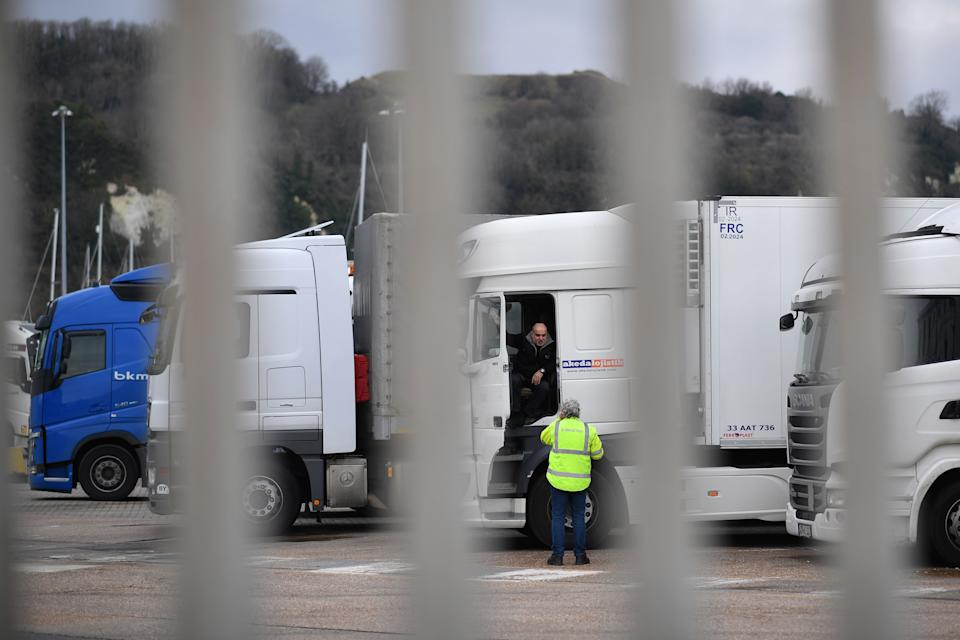 Drivers wait with their parked-up freight trucks at the Motis freight clearance centre at the port of Dover on the south coast of England on January 15, 2021, as hauliers get used to life under the post-Brexit trade deal. - British companies are struggling with a large amount of red tape as a result of Brexit, with senior government minister Michael Gove recently admitting that there would be