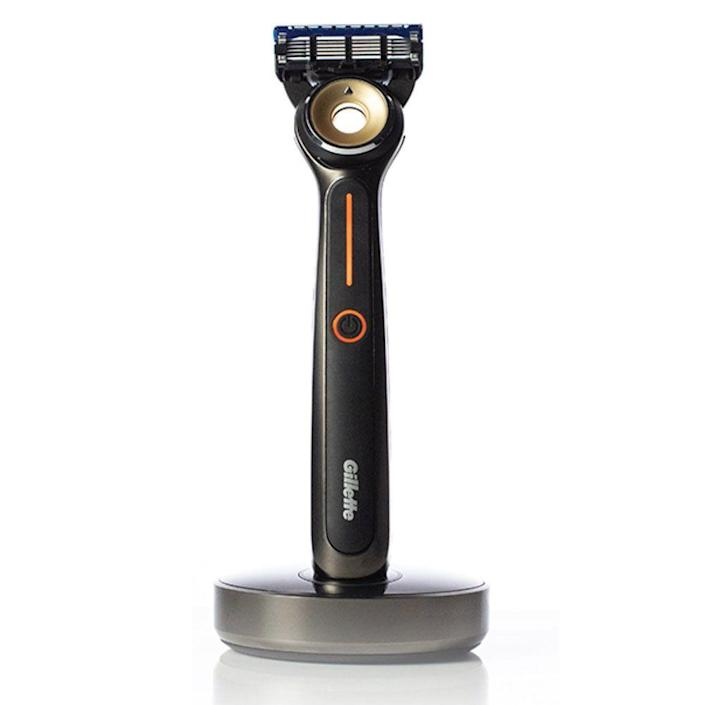 """<p>gillette.com</p><p><strong>$160.00</strong></p><p><a href=""""https://go.redirectingat.com?id=74968X1596630&url=https%3A%2F%2Fondemand.gillette.com%2Fen-us%2Fshop%2Fproducts%2Fhot-shave&sref=https%3A%2F%2Fwww.menshealth.com%2Ftechnology-gear%2Fg19521968%2Fcool-gifts-for-dad%2F"""" rel=""""nofollow noopener"""" target=""""_blank"""" data-ylk=""""slk:BUY IT HERE"""" class=""""link rapid-noclick-resp"""">BUY IT HERE</a></p><p>Give your dad one of the most <a href=""""https://www.menshealth.com/grooming/a27574881/mens-health-grooming-awards-2019/"""" rel=""""nofollow noopener"""" target=""""_blank"""" data-ylk=""""slk:innovative, unique grooming"""" class=""""link rapid-noclick-resp"""">innovative, unique grooming</a> gifts this year that he'll actually use. He can turn it on, adjust the heat level, and get one of the smoothest shaves from the comfort of his own home. If he's missing his regular barbershop shaves these days, this cool Father's Day gift idea is perfect for Dad. </p>"""