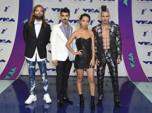 <p>DNCE coordinated their looks (and Joe Jonas showed off a new mustache). (Photo: AP) </p>