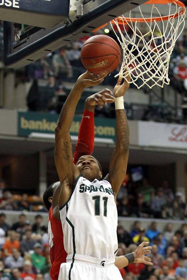 INDIANAPOLIS, IN - MARCH 11:  Keith Appling #11 of the Michigan State Spartans attempts a shot against the Ohio State Buckeyes during the Final Game of the 2012 Big Ten Men's Conference Basketball Tournament at Bankers Life Fieldhouse on March 11, 2012 in Indianapolis, Indiana.  (Photo by Andy Lyons/Getty Images)