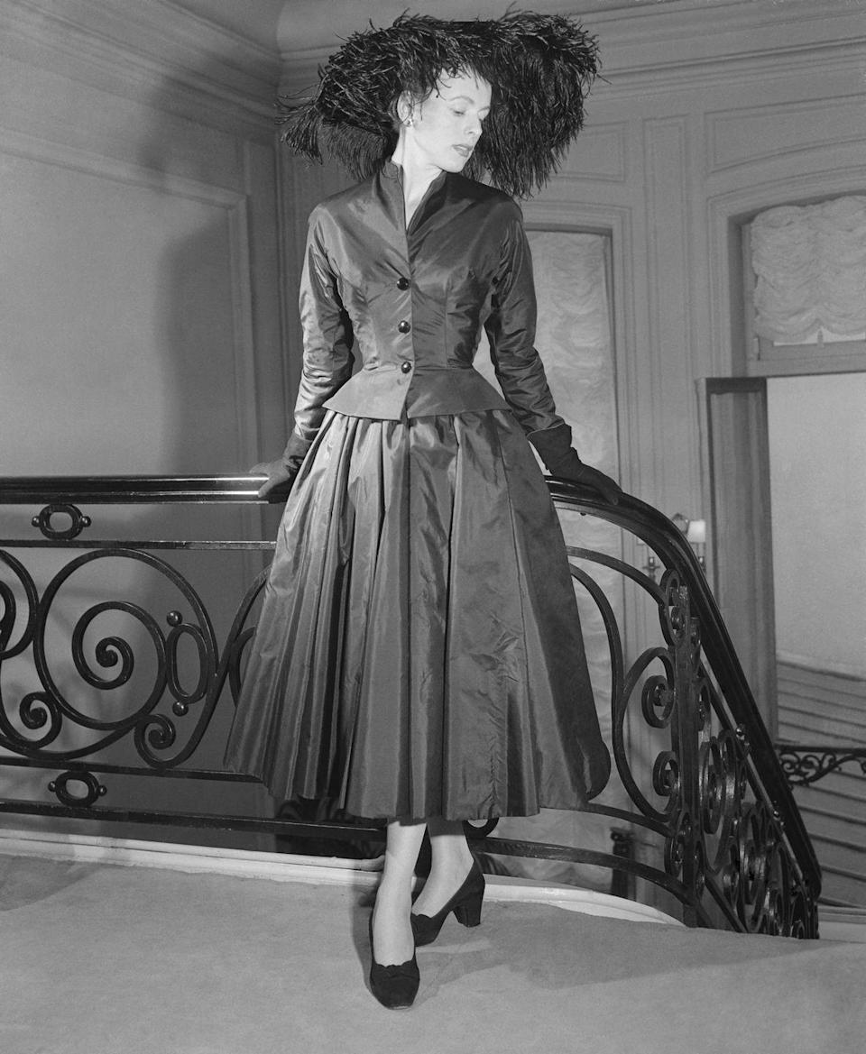 <p>Likewise, Christian Dior employed a fuller skirt silhouette in his fall 1951 collection. The early '50s often saw a fall ensemble completed with a coordinated hat or headpiece. <br></p>