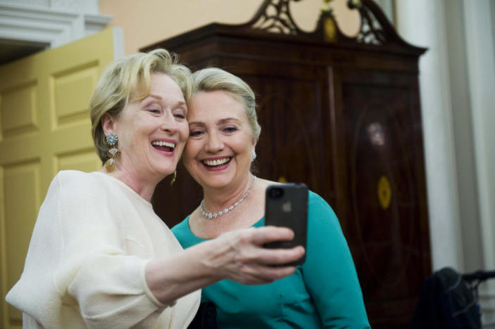 <p>Actress Meryl Streep, left, uses her iPhone to take a photo with Secretary of State Hillary Clinton after the Kennedy Center Honors gala at the State Department in Washington in December 2012. (Photo: Kevin Wolf/AP)</p>