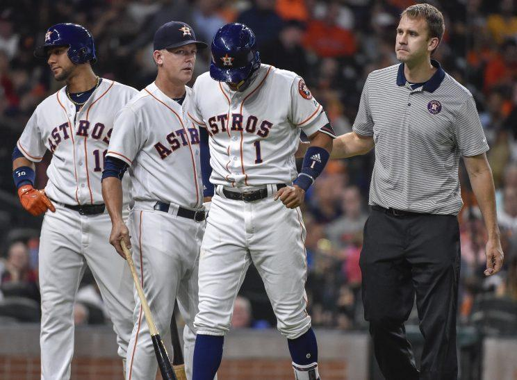 A torn ligament in his thumb will put Carlos Correa on the sideline for a few weeks. (AP Photo)