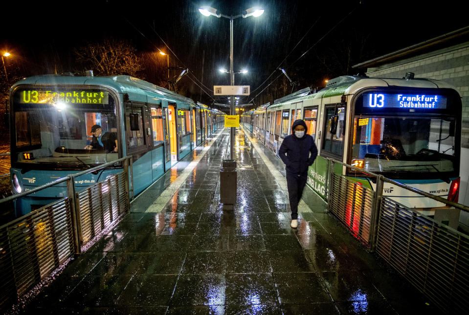 A man wearing a face mask has left a train at a subway station in Oberursel near Frankfurt, Germany, on early Monday, March 15, 2021. Numbers of Corona infections in Germany are rising again. (AP Photo/Michael Probst)